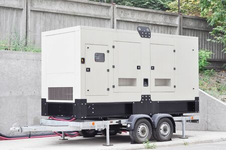 Photo for Backup Generator on the trailer. Mobile Backup Generator .Standby Generator - Outdoors Power Equipment - Royalty Free Image
