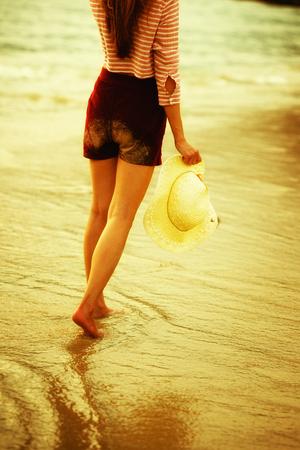 asia woman walking along the beach