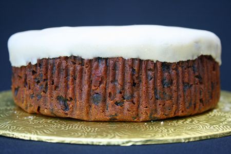 Fruit cake on a stand before being decorated.