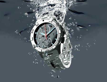 metal wrist watch is under water.