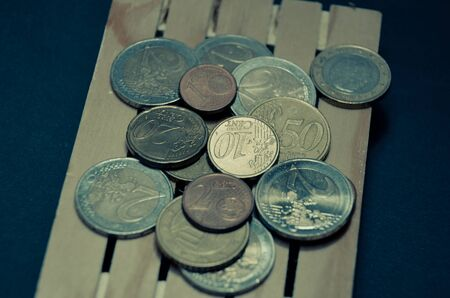 Retro vintage photo effect of euro coins money on the pallet. Prepared for transport. Macro photo european currency.