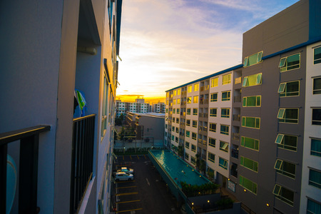 Modern condo residential buildings on afternoon with sun set
