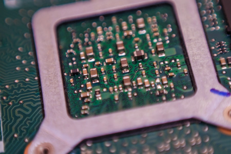 Electical integrate circuit and microship on mainboard close up communication background