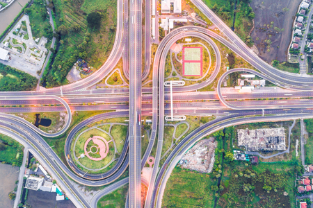 Photo pour Intersection traffic road aerial view in morning transport industrail - image libre de droit
