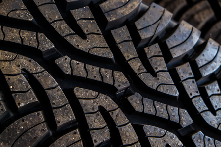 Stack of car tire close up in garage shop, Vehicle industry