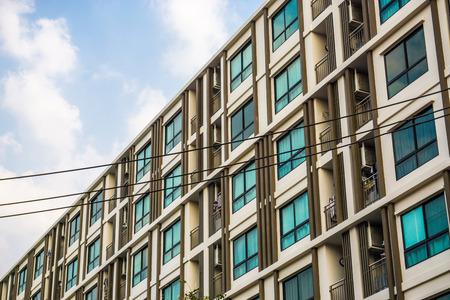 Photo pour Modern condominium block building with blue sky cloud real estate business industry - image libre de droit
