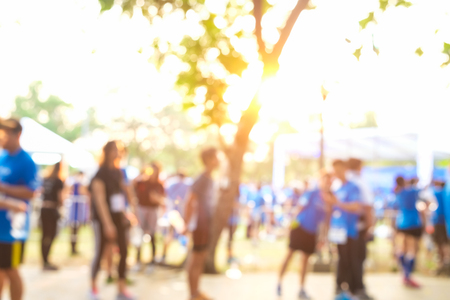 Photo pour Blurred group of running people in marathon run with morning sun light - image libre de droit