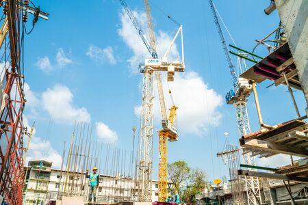 Photo pour Construction site condominium building with man, Real estate industry - image libre de droit