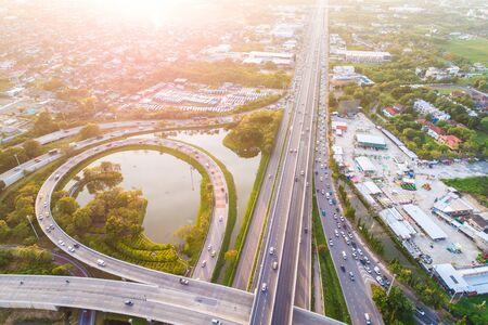 Photo pour Aerial view transport junction road car movement with sunset light, Vehicle on road - image libre de droit