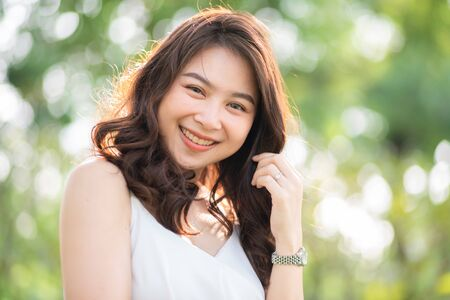 Photo for Asian beautiful women smiling in city public park morning light, Women recreation outdoor - Royalty Free Image