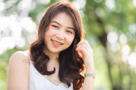 Foto de Portrait of smiling beautiful asian women in park morning light with bokeh half body portrait - Imagen libre de derechos
