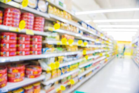 Photo pour Abstract blurred modern supermarket with many various goods people shopping - image libre de droit