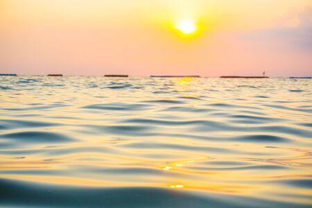 Photo pour Abstract blurred sea wave bach sunset warm light new hope concept - image libre de droit