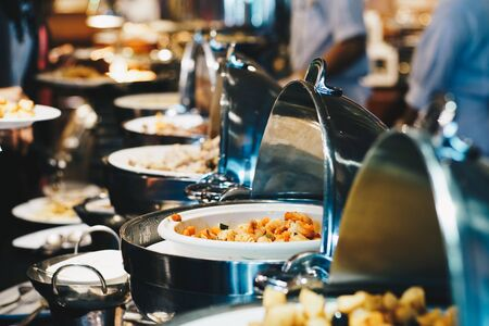 Photo pour Crowd of people enjoying buffet food meal dining Food Options Eating Concept in hotel buffet - image libre de droit