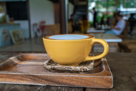 Photo pour Hot latte art coffee in cup on wooden table aroma drink - image libre de droit
