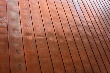 A copper wall with spaced seams and a high perspective to one corner