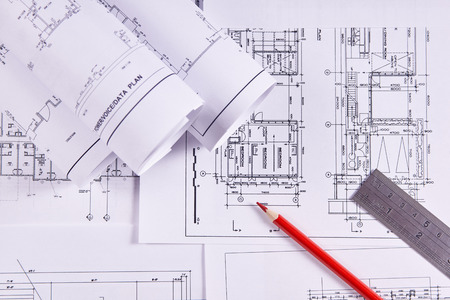 Photo pour Engineering background. Construction drawings of buildings and structures next to ruler and red pencil. Close-up. - image libre de droit