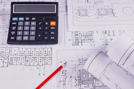 Photo pour Engineering background. Construction drawings of buildings and structures next to red pencil and calculator. Close-up. - image libre de droit