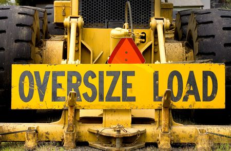 Photo of a sign for an OVERSIZE LOAD.