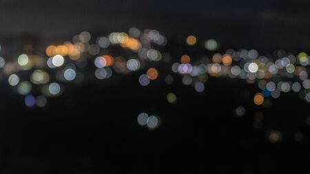 Photo pour Beautiful defocused or blurry night light view of the kalimpong town with details. The town is in West Bengal. - image libre de droit