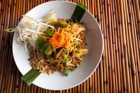 Photo pour Chicken pad Thai dish of stir fried rice noodles with a contemporary presentation. - image libre de droit