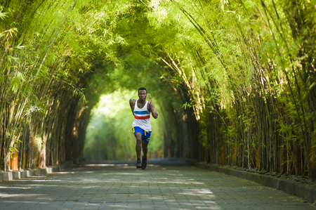 Photo pour healthy lifestyle portrait of young athletic and attractive black African American runner man doing running workout training outdoors on urban city park in fitness sport and wellness concept - image libre de droit