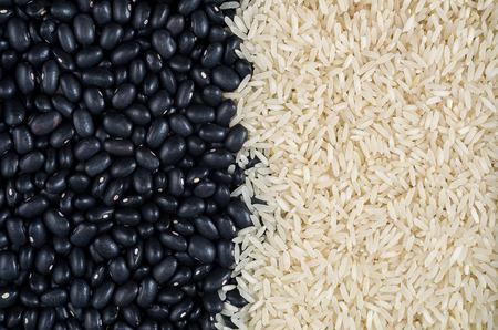 Foto de Raw food, raw black beans, rice, vegan, background, texture. - Imagen libre de derechos
