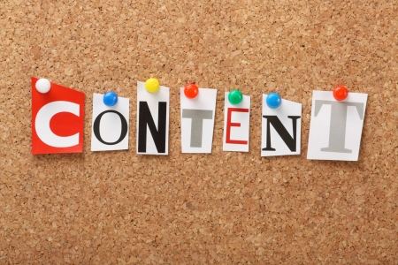 The word Content in cut out magazine letters pinned to a cork notice board  Content is an important part of marketing and search engine optimization for web content and advertising