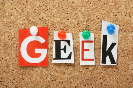 The word Geek in cut out magazine letters pinned to a cork notice board