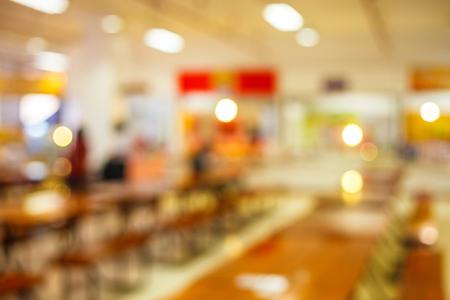 Foto de blur image of cafeteria in the University and sun light - Imagen libre de derechos