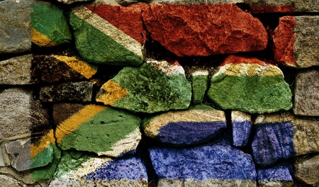 The South African Flag painted on to a stone wall.