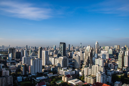 Cityscape under clouds and blue sky.