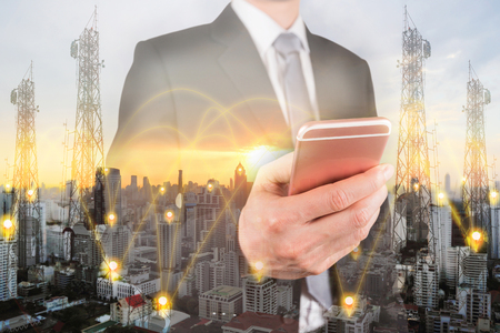Photo for Double exposure of businessman use smartphone, communication node tower or 4G 5G network telephone cellsite and cityscape urban at sunset as business, technology and telecom concept - Royalty Free Image