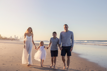 Family of four portrait on the beach, very soft selective focus, toning