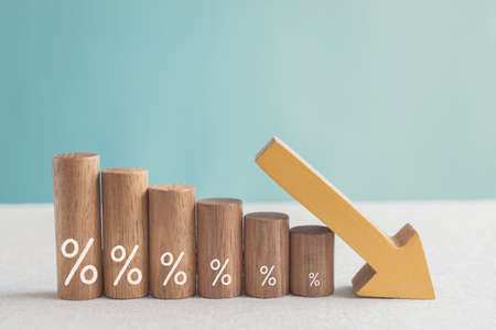 Photo for Wooden blocks with percentage sign and down arrow, financial recession crisis, interest rate decline, risk management concept - Royalty Free Image
