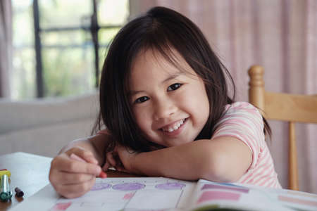Photo for Young Asian girl drawing at home, homeschool education - Royalty Free Image