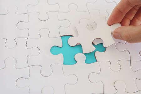 Photo pour Hands with jigsaw puzzle pieces, Business strategy planning, Alzheimer's disease,  Autism and mental health concept - image libre de droit