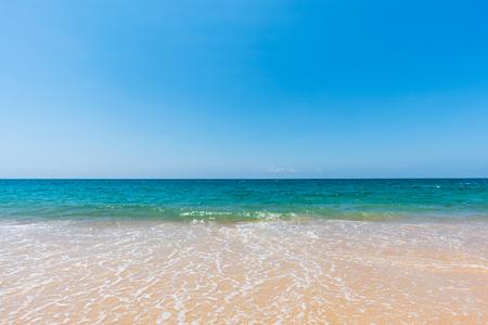 Foto de soft sea wave on sand beach and scenic natural seascape background - Imagen libre de derechos