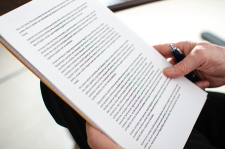 Foto de Reading documents, closeup - Imagen libre de derechos