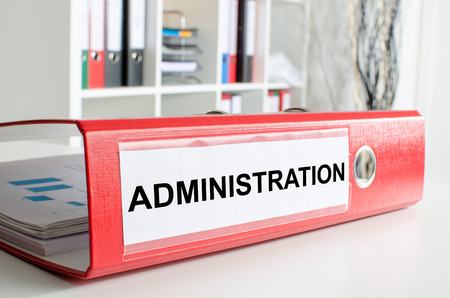 Administration wording on the back of a red binder