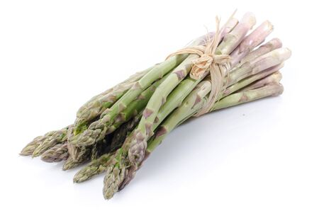 Photo pour Bunch of fresh green asparagus, isolated on white - image libre de droit