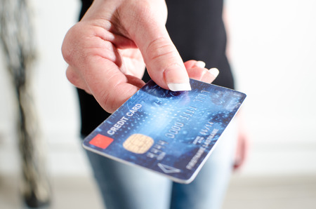 Woman hand showing credit card, closeup