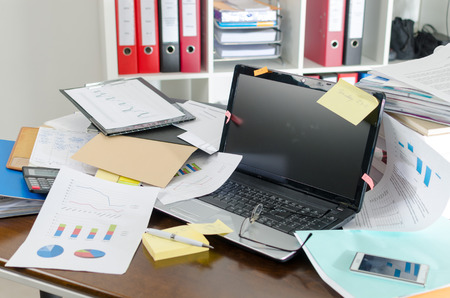 Photo for View of a untidy and cluttered desk - Royalty Free Image