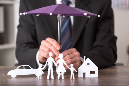 Photo for Concept of insurance with umbrella over a house, a car and a family - Royalty Free Image