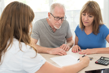 Photo for Senior couple meeting financial adviser for investment - Royalty Free Image