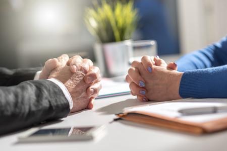Photo pour Situation of business negotiation between businesswoman and businessman, light effect - image libre de droit