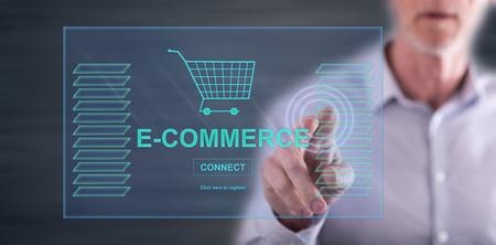 Photo pour Man touching an e-commerce concept on a touch screen with his finger - image libre de droit