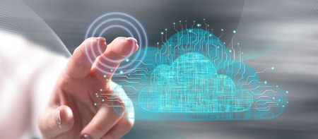 Foto de Woman touching a cloud networking concept on a touch screen with her finger - Imagen libre de derechos