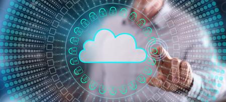 Foto de Man touching a cloud networking concept on a touch screen with his finger - Imagen libre de derechos