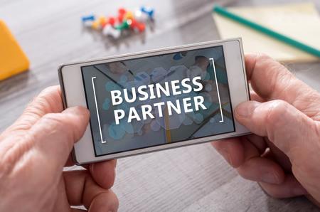 Photo pour Business partner concept on mobile phone - image libre de droit